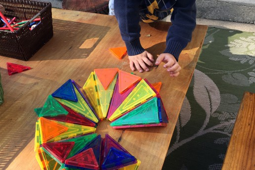 Building with Magna Tiles in the Yard